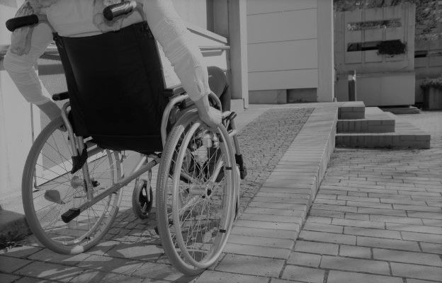 woman in wheelchair outside building
